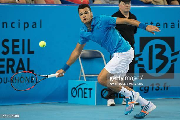 France's Jo-Wilfried Tsonga returns the ball to France's Edouard Roger-Vasselin during their Open 13 ATP tennis tournament match on February 21, 2014...