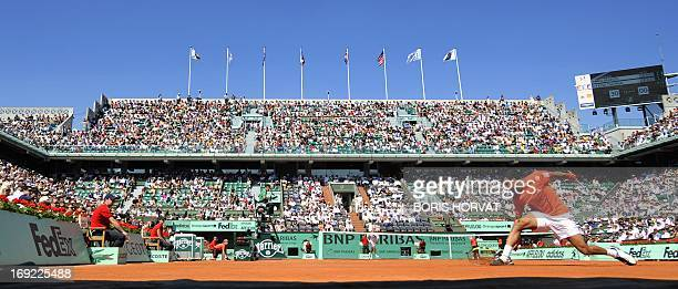 France's JoWilfried Tsonga returns the ball to Germany's Daniel Brands during during their men's first round match in the French Open tennis...