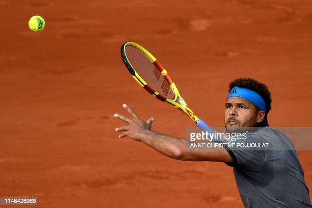 France's JoWilfried Tsonga returns the ball to Germany's Peter Gojowczyk during their men's singles first round match on day two of The Roland Garros...
