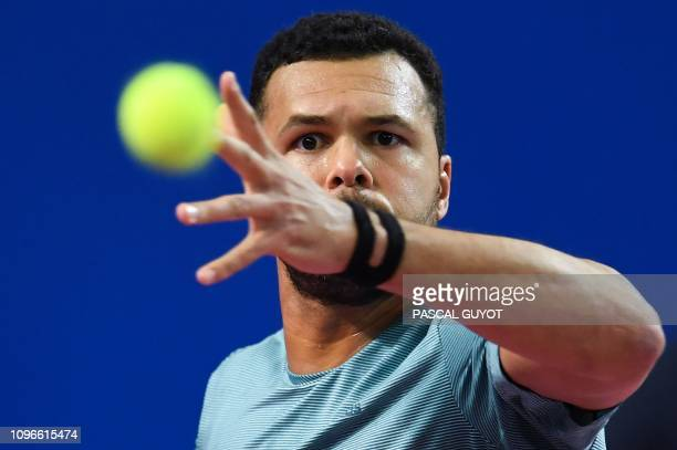 France's JoWilfried Tsonga returns the ball to Latvia's Radu Albot during their semifinal tennis match at the Open Sud de France ATP World Tour in...
