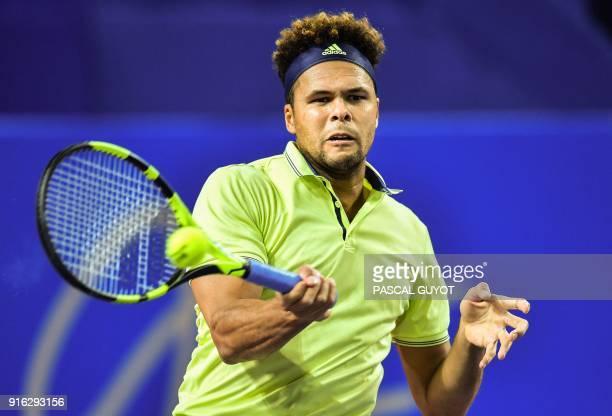 France's JoWilfried Tsonga returns the ball to Russia's Andrey Rublev during their quarterfinal singles tennis match at the Open Sud de France ATP...