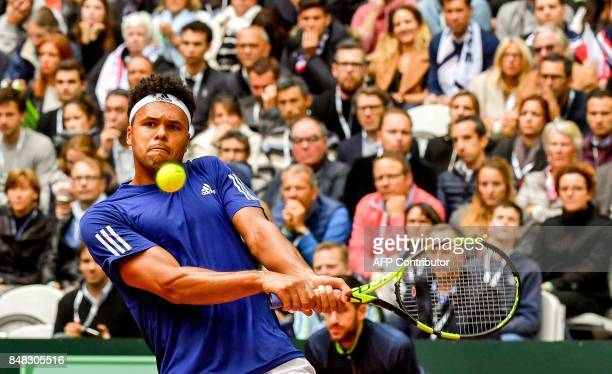 France's Jo-Wilfried Tsonga returns the ball to Serbia's Dusan Lajovic during their singles rubber in the Davis Cup World Group semi-final tennis...