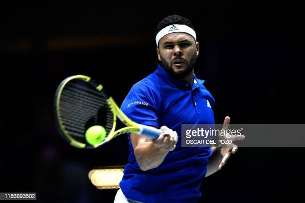 TOPSHOT France's JoWilfried Tsonga returns the ball to Serbia's Filip Krajinovic during the singles tennis match between France and Serbia at the...