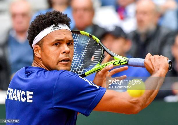 France's JoWilfried Tsonga returns the ball to Serbia's Laslo Djere during their Davis Cup world group semifinal tennis match between France and...