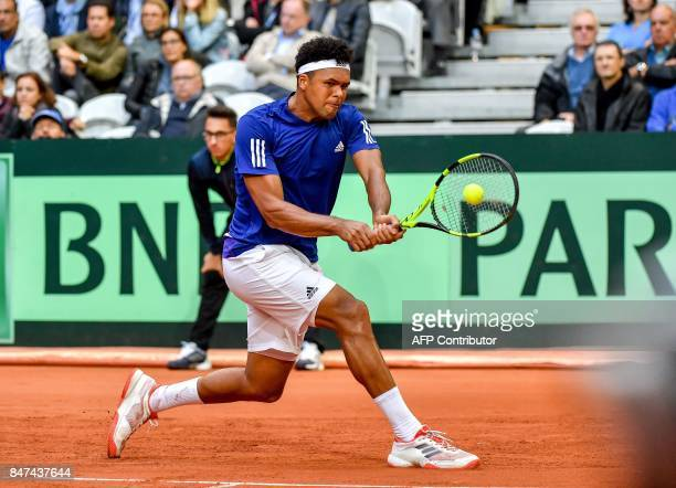 France's JoWilfried Tsonga returns the ball to Serbia's Laslo Djere during their singles rubber for the Davis Cup World Group semifinal tennis match...