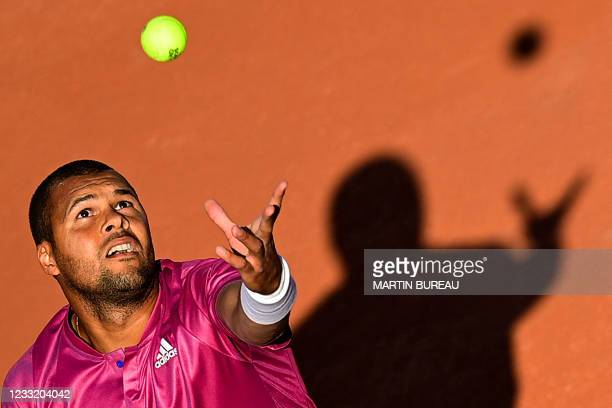 France's Jo-Wilfried Tsonga serves the ball to Japan's Yoshihito Nishioka during their men's singles first round tennis match at the Court Suzanne...
