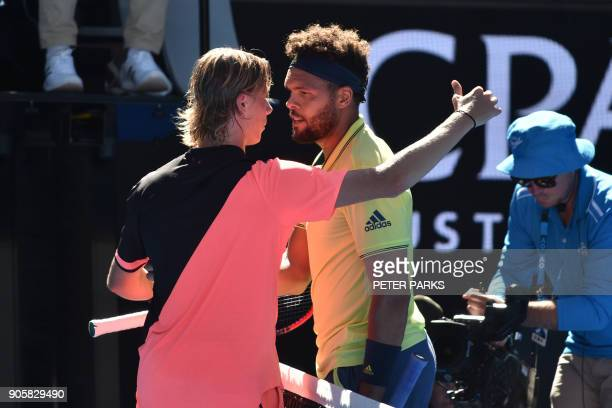 France's JoWilfried Tsonga shakes hands with Canada's Denis Shapovalov after winning their men's singles second round match on day three of the...