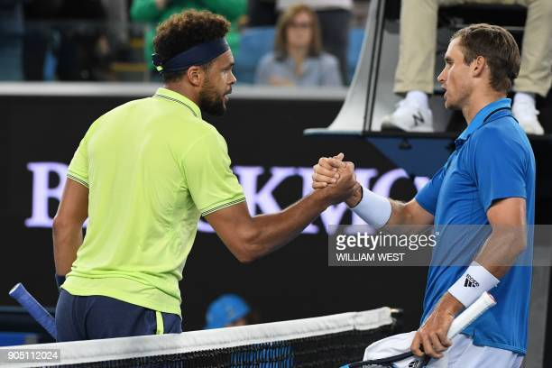 France's JoWilfried Tsonga shakes hands with Kevin King of the US after their men's singles first round match on day one of the Australian Open...