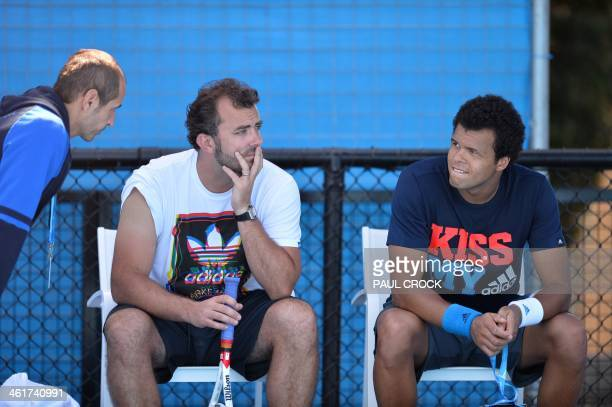 France's JoWilfried Tsonga speaks with coaches during a practice session ahead of the 2014 Australian Open tennis tournament in Melbourne on January...