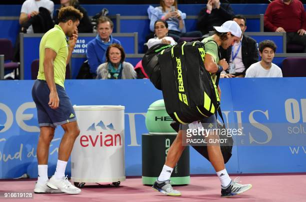 France's JoWilfried Tsonga walks after withdrawing against France's Lucas Pouille during their semi final tennis match at the Open Sud de France ATP...