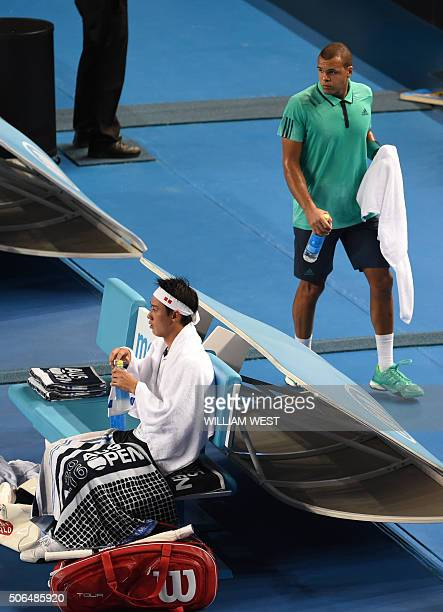 France's Jo-Wilfried Tsonga walks off court for a medical break during his men's singles match against Japan's Kei Nishikori on day seven of the 2016...