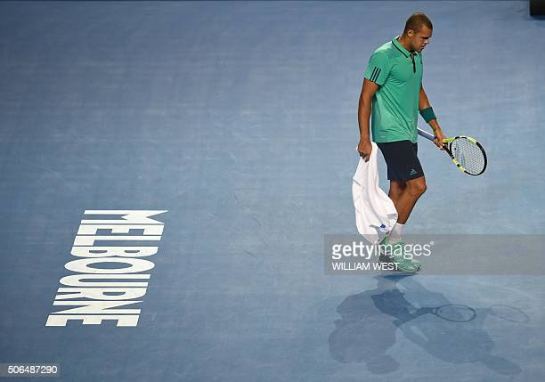 France's Jo-Wilfried Tsonga walks on court during his men's singles match against Japan's Kei Nishikori on day seven of the 2016 Australian Open...