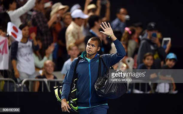 France's Jo-Wilfried Tsonga waves to the crowd following his defeat to Japan's Kei Nishikori in their men's singles match on day seven of the 2016 of...