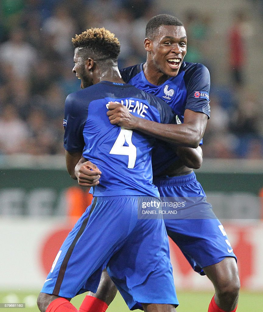 France's Jérôme Onguene and Issa Diop (R) celebrate winning the Under 19 Football European Championships final match France vs Italy in Sinsheim, southern Germany, on July 24, 2016. / AFP / DANIEL