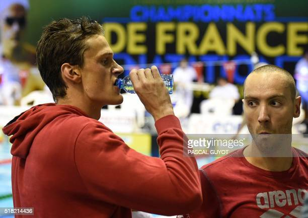 France's Jérémy Stravius reacts with Yannick Agnel after winning the men's 200m freestyle final of the French swimming championship in Montpellier on...