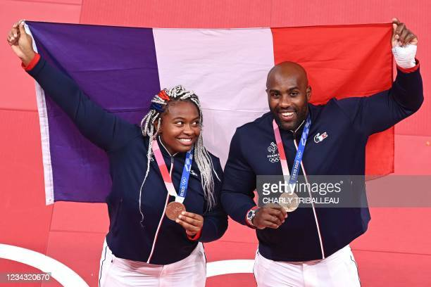France's Judo bronze medalists Romane Dicko and Teddy Riner pose during the Tokyo 2020 Olympic Games at the Nippon Budokan in Tokyo on July 30, 2021.