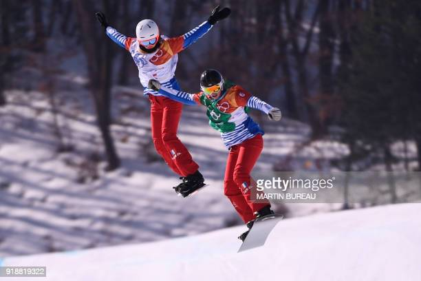 France's Julia Pereira De Sousa Mabileau and France's Chloe Trespeuch compete during the women's snowboard cross semi-finals at the Phoenix Park...