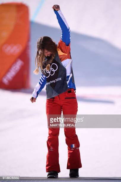 France's Julia Pereira De Sousa Mabileau celebrates on the podium during the victory ceremony after the women's snowboard cross big final at the...