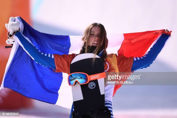 TOPSHOT France's Julia Pereira De Sousa Mabileau celebrates on the podium during the victory ceremony after the women's snowboard cross big final at...