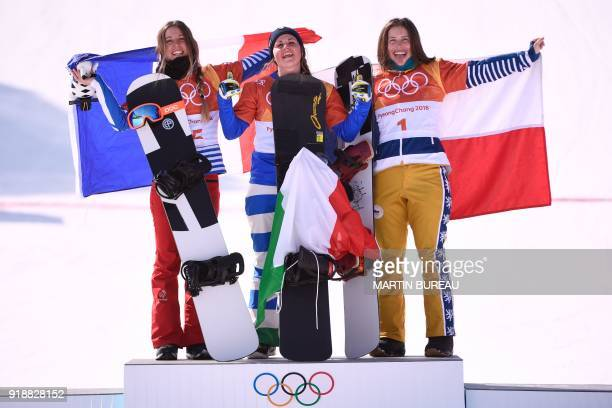 France's Julia Pereira De Sousa Mabileau, Italy's Michela Moioli and Czech Republic's Eva Samkova celebrate on the podium during the victory ceremony...