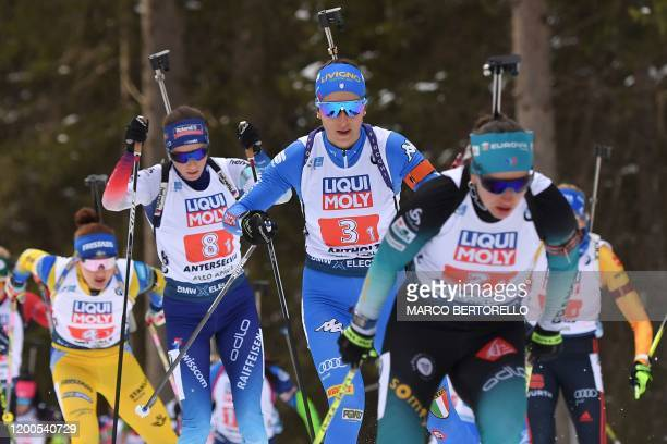 France's Julia Simon, Italy's Lisa Vittozzi, Switzerland's Selina Gasparin and Sweden's Linn Persson compete in the IBU Biathlon World Cup 4x6 Mixed...