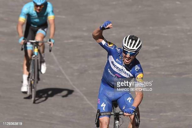 France's Julian Alaphilippe celebrates as he crosses line ahead of Denmark's Jakob Fuglsang to win the one-day classic cycling race Strade Bianche on...