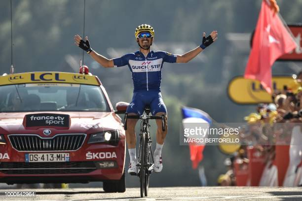 France's Julian Alaphilippe celebrates as he crosses the finish line to win the tenth stage of the 105th edition of the Tour de France cycling race...