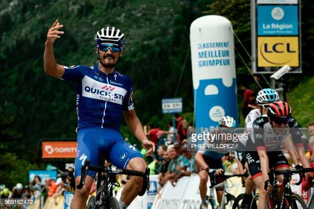 TOPSHOT France's Julian Alaphilippe celebrates as he crosses the finish line ahead of Ireland's Daniel Martin Britain's Geraint Thomas and France's...