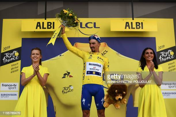 France's Julian Alaphilippe celebrates his overall leader's yellow jersey on the podium of the tenth stage of the 106th edition of the Tour de France...