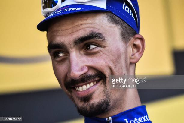 France's Julian Alaphilippe celebrates on the podium after winning the 16th stage of the 105th edition of the Tour de France cycling race between...