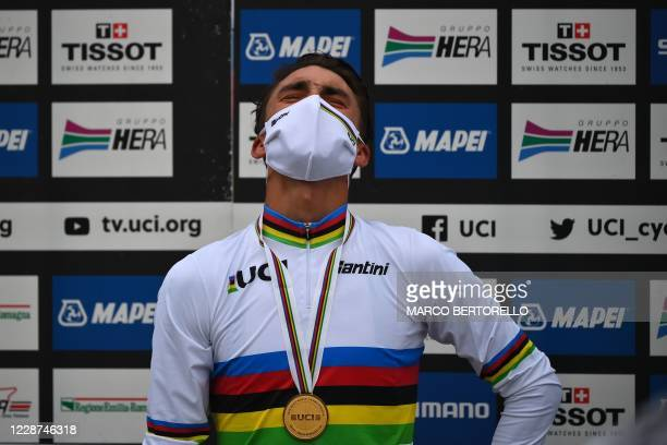 France's Julian Alaphilippe celebrates on the podium after winning the Men's Elite Road Race, a 258.2-kilometer route around Imola, Emilia-Romagna,...