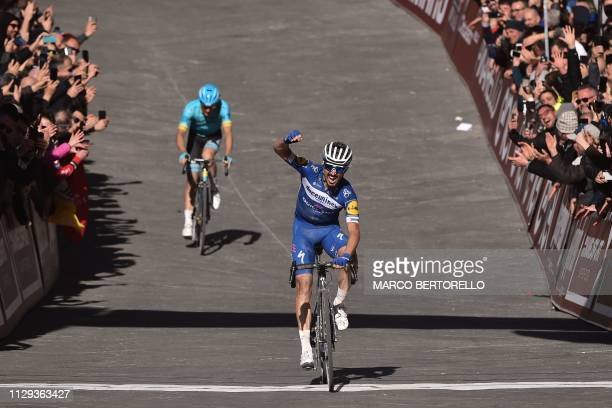France's Julian Alaphilippe crosses the finish line to win the one-day classic cycling race Strade Bianche on March 9, 2019 in Siena, Tuscany.