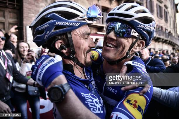 France's Julian Alaphilippe embraces Czech teammate Zdenek Stybar after winning the one-day classic cycling race Strade Bianche on March 9, 2019 in...