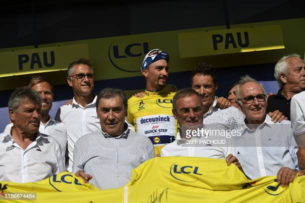 France's Julian Alaphilippe poses with former cycling champions France's Bernard Hinault , Belgium's Eddy Merckx, France's Bernard Thevenet ,...