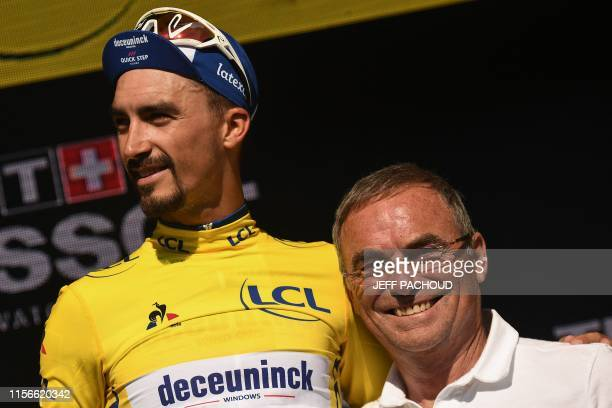 TOPSHOT France's Julian Alaphilippe poses with former French champion Bernard Hinault as he celebrates his overall leader's yellow jersey on the...
