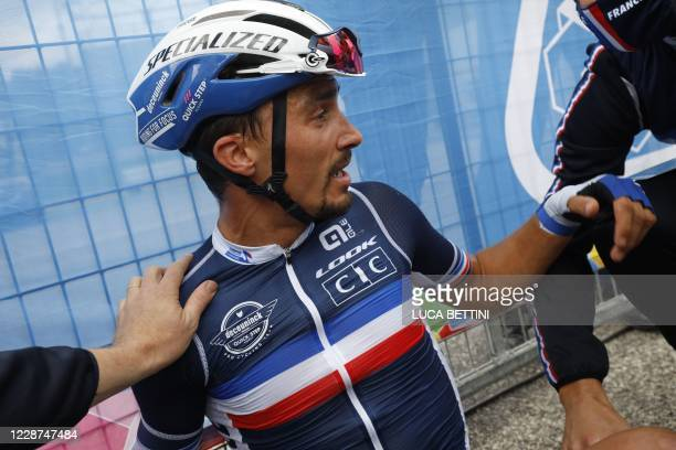 France's Julian Alaphilippe reacts after he crossed the finish line to win the Men's Elite Road Race, a 258.2-kilometer route around Imola,...