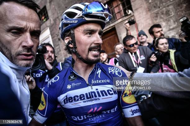 France's Julian Alaphilippe reacts after winning the one-day classic cycling race Strade Bianche on March 9, 2019 in Siena, Tuscany.