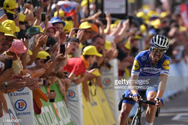 France's Julian Alaphilippe reacts on the finish line of the eighth stage of the 106th edition of the Tour de France cycling race between Macon and...