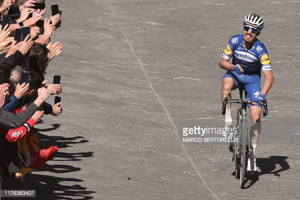 France's Julian Alaphilippe rides on his way to cross the finish and win the one-day classic cycling race Strade Bianche on March 9, 2019 in Siena,...