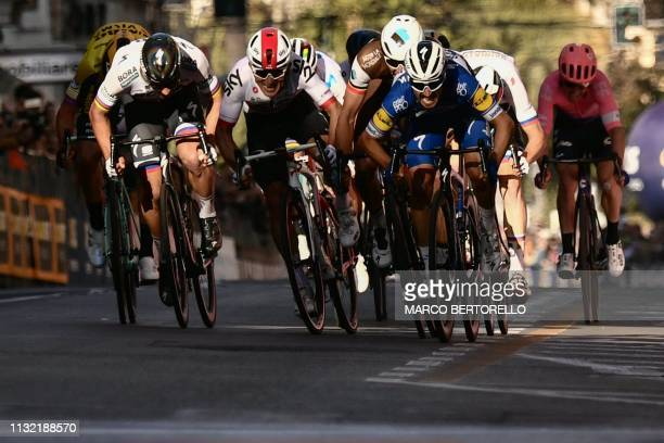 France's Julian Alaphilippe sprints in the last meters to win ahead of Belgium's Oliver Naesen and Poland's Michal Kwiatkowski the oneday classic...