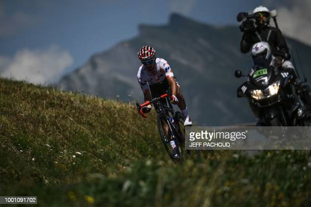 TOPSHOT France's Julian Alaphilippe wearing the best climber's polka dot jersey rides down the Saisies pass following the ascent of Bisanne during...