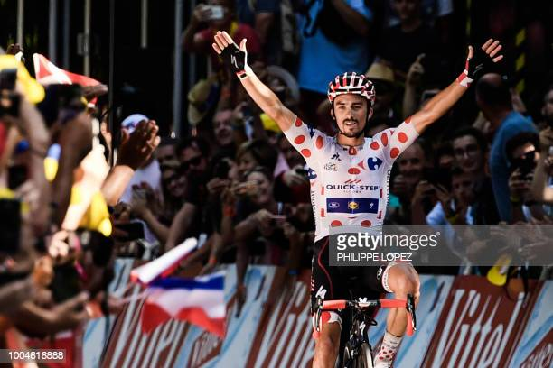 France's Julian Alaphilippe, wearing the best climber's polka dot jersey, celebrates as he crosses the finish line to win the 16th stage of the 105th...