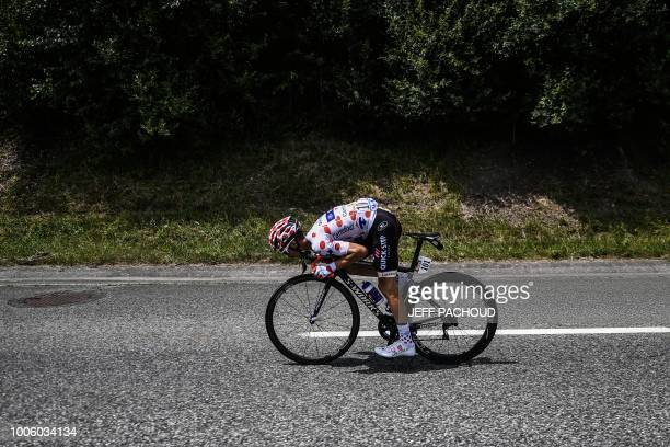 TOPSHOT France's Julian Alaphilippe wearing the best climber's polka dot jersey looks for the best aerodynamic position to reduce drag during a...