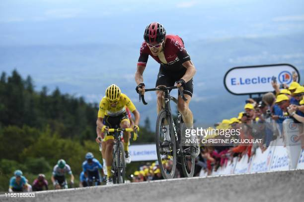 France's Julian Alaphilippe , wearing the overall leader's yellow jersey, Great Britain's Geraint Thomas and cyclists ride in the last kilometre of...