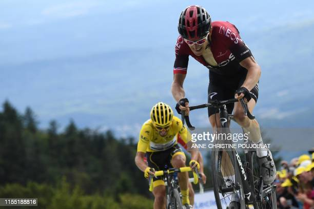 France's Julian Alaphilippe , wearing the overall leader's yellow jersey, Great Britain's Geraint Thomas ride in the last kilometre of the sixth...