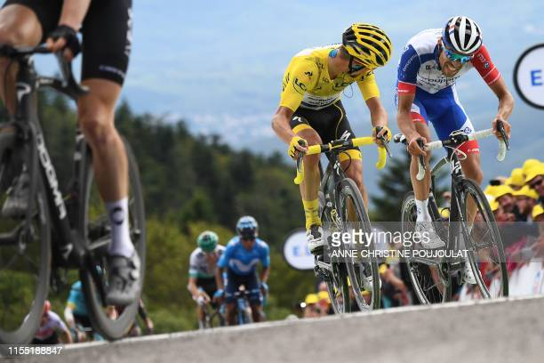 France's Julian Alaphilippe , wearing the overall leader's yellow jersey and France's Thibaut Pinot ride in the last kilometres of the sixth stage of...