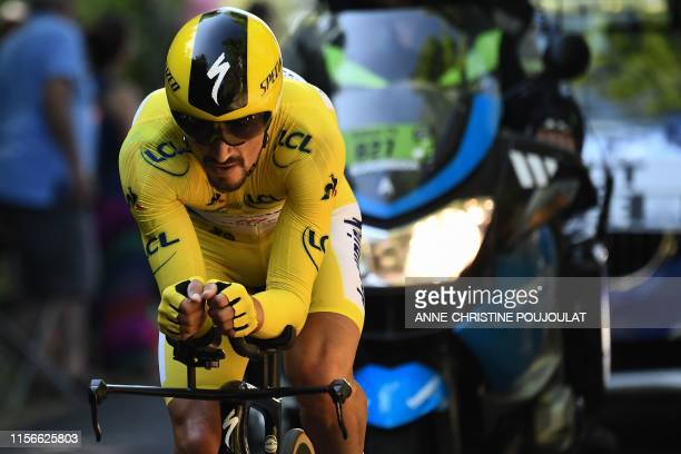 France's Julian Alaphilippe, wearing the overall leader's yellow jersey rides during the thirteenth stage of the 106th edition of the Tour de France...