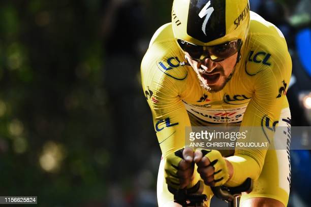 France's Julian Alaphilippe wearing the overall leader's yellow jersey rides during the thirteenth stage of the 106th edition of the Tour de France...