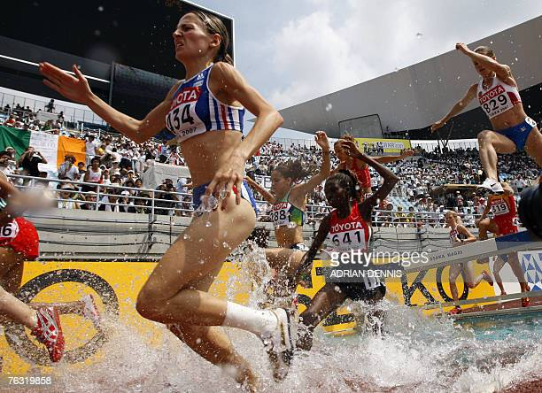 France's Julie Coulard and Kenya's Eunice Jepkorir compete during the women?s 3000m steeplechase first round, 25 August 2007, at the 11th IAAF World...