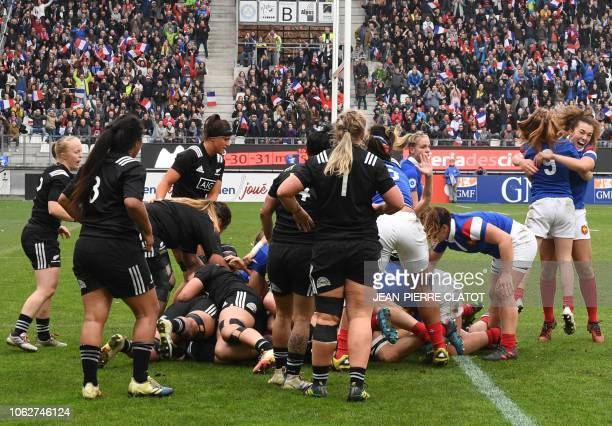 France's Julie Duval scores a try during the women rugby union match between France and New Zealand on November 17, 2018 at the Stade des Alpes in...